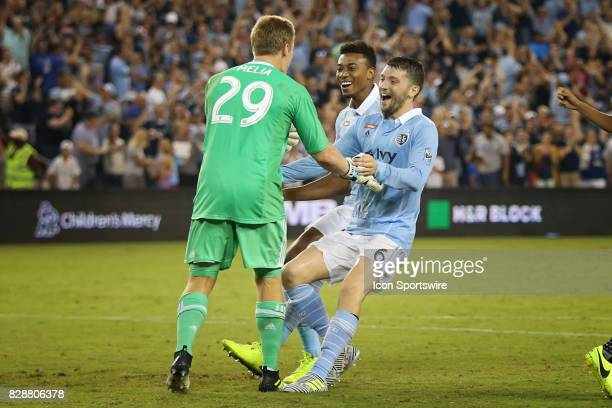 Sporting KC celebrates goalkeeper Tim Melia's save in penalty kicks to win the semifinal of the Lamar Hunt US Open Cup against the San Jose...