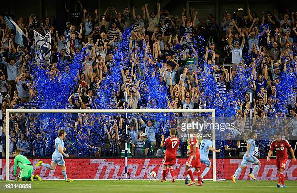 Sporting KC fans cheer as Dom Dwyer scores on a penalty kick against goalkeeper Joe Bendik and Toronto FC during the game at Sporting Park on May 23...