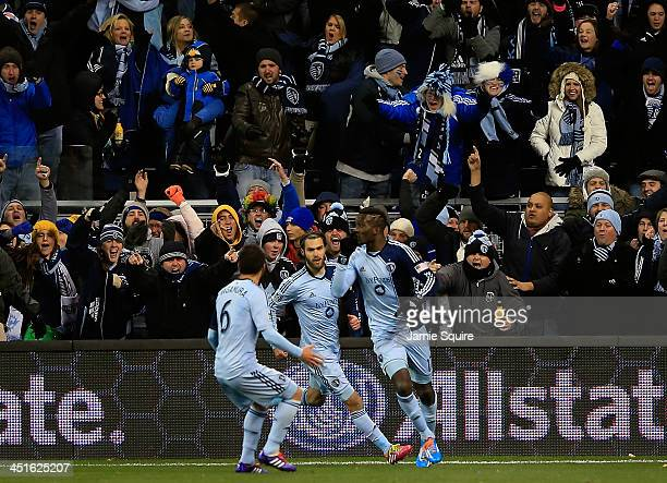 Sporting KC fans cheer as Paulo Nagamura and Graham Zusi celebrate a goal by C.J. Sapong during Leg 2 of the Eastern Conference Championship against...