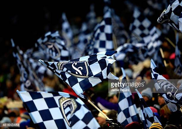 Sporting KC fans wave flags during Leg 2 of the Eastern Conference Championship against the Houston Dynamo at Sporting Park on November 23 2013 in...