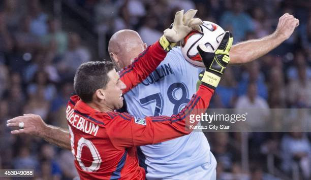 Sporting KC goalkeeper Andy Gruenebaum and defender Aurelien Collin get tied up going for a shot on goal in the second half against the Philadelphia...