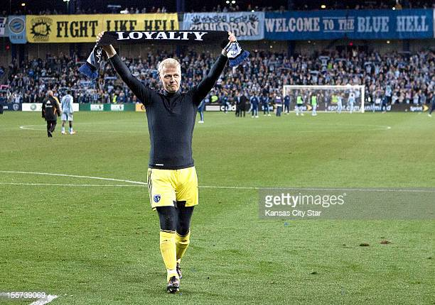 Sporting KC goalkeeper Jimmy Nielsen displays a scarf with 'Loyalty' written on it after a loss to the Houston Dynamo in aggregate scoring to end...