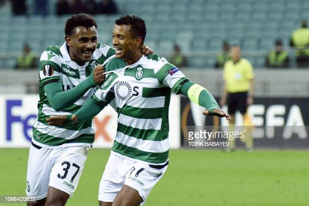 Sporting Lisbon's Brazilian midfielder Wendel and Sporting Lisbon's Portuguese midfielder Nani celebrate during the UEFA Europa League group E...