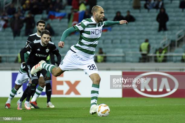 Sporting Lisbon's Dutch forward Bas Dost scores from the penalty spot during the UEFA Europa League group E football match between Qarabag FK and...