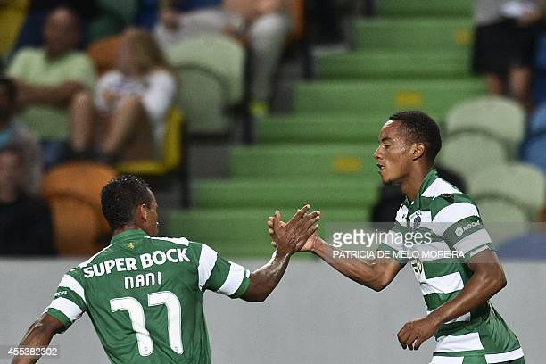 Sporting Lisbon's Peruvian forward Andre Carrilho celebrates with his teammate midfielder Luis Carlos da Cunha Nani after scoring a goal during the...