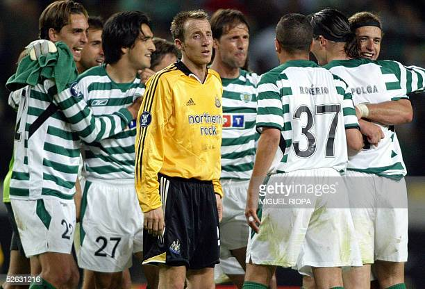 Sporting Lisbon's players celebrate their victory next Newcastle's Lee Bowyer after their quarter final second leg Uefa Cup football match at Jose...