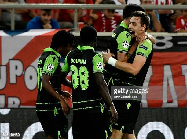 Sporting Lisbon's players including midfielder Bruno Fernandes celebrate their third goal during the Group D UEFA Champions League football match...