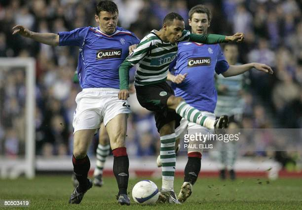 Sporting Lisbon's Portugese forward Li?dson miskicks the ball while under pressure from Rangers' Scottish forward Lee McCulloch and Scottish...