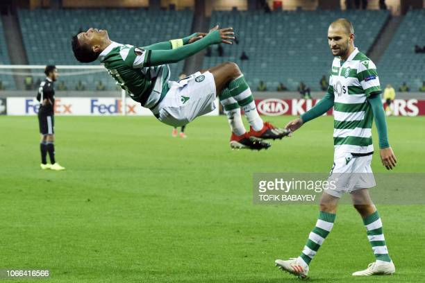 Sporting Lisbon's Portuguese midfielder Nani does a somersault while celebrating a goal during the UEFA Europa League group E football match between...