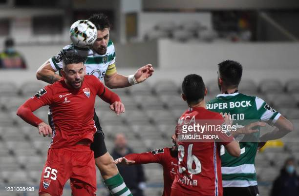 Sporting Lisbon's Uruguayan defender Sebastian Coates heads the ball over Gil Vicente's Portuguese defender Henrique Gomes to score a goal during the...