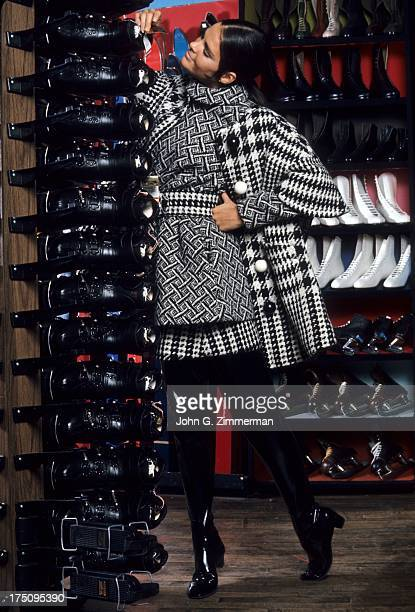Portrait of actress Alice MacGraw wearing plaid and layered tunic by Rudi Gernreich and boots by Capezio during photo shoot at Princeton Skate Ski...