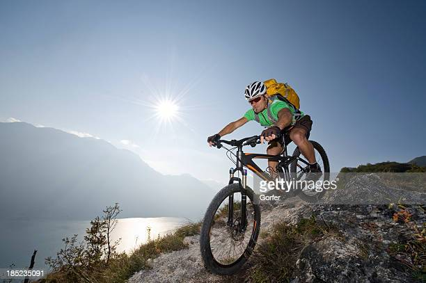 Sporting man riding on single track trail