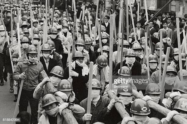 Sporting masks and helmets and armed with an assortment of poles Zengakuren students stage a mammoth demonstration here on October 21st in...