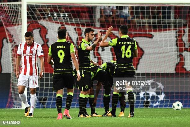 Sporting players celebrate after Gelson Martins scored during the UEFA Champions League Group D football match between Olympiacos Piraeus FC and...