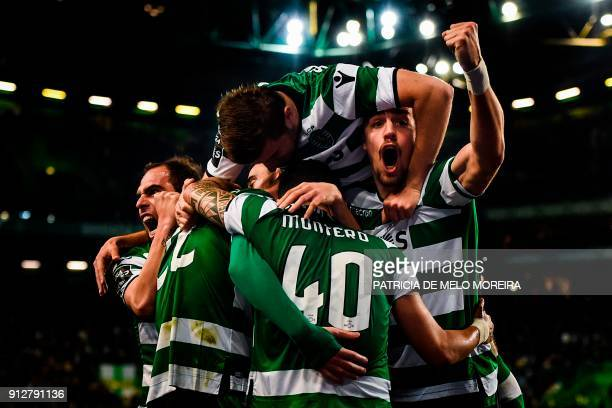 Sporting players celebrate after Sporting's French defender Jeremy Mathieu scored during the Portuguese league football match between Sporting CP and...