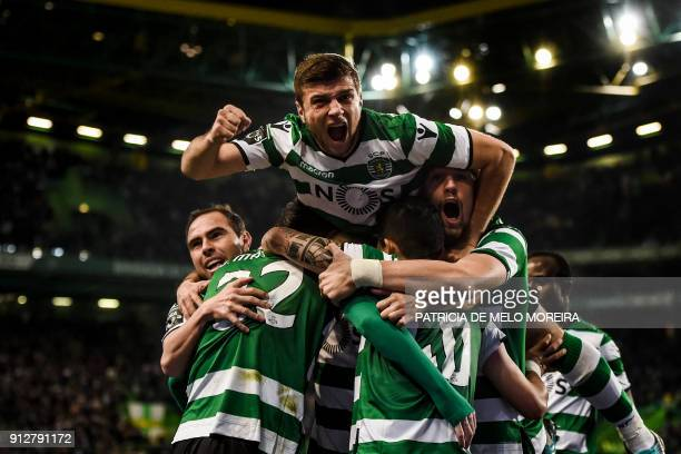 TOPSHOT Sporting players celebrate after Sporting's French defender Jeremy Mathieu scored during the Portuguese league football match between...