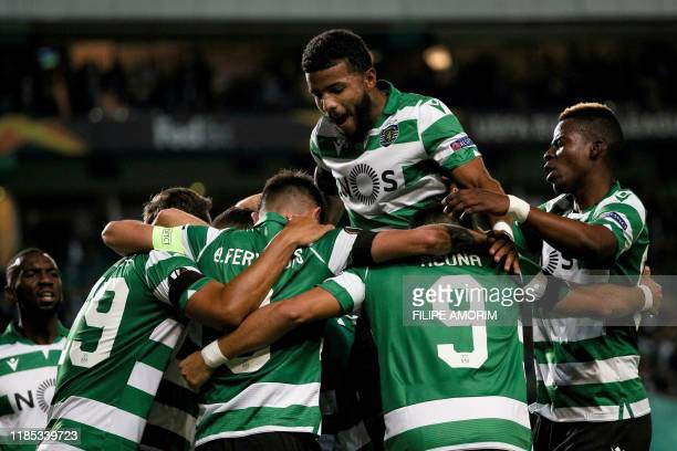 Sporting players celebrate teammate Brazilian forward Luiz Phellype's goal during the UEFA Europa League Group D football match between Sporting CP...