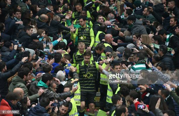 Sporting players celebrate with supporters after winning the Portuguese League Cup at the end of the Portuguese League Cup Final match between...