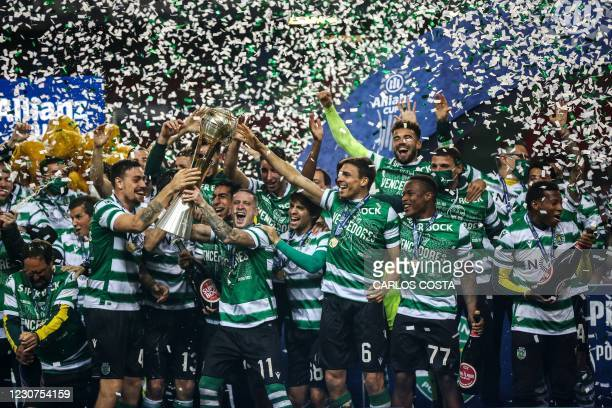 Sporting players celebrate with their trophy after winning the Portuguese Taca da Liga final football match between Sporting CP and SC Braga at the...