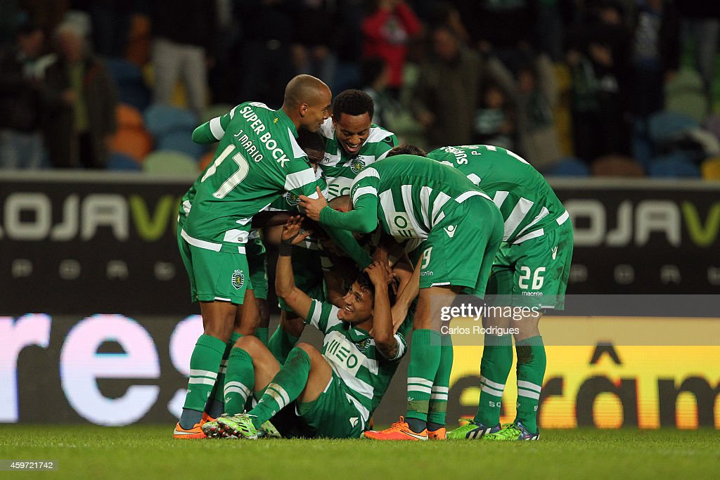 Sporting players celebrates Sporting«s second goal scored by Sporting's forward Fredy Montero during the Primeira Liga Portugal match between Sporting CP and Vitoria Setubal at Estadio Jose Alvalade on November 29, 2014 in Lisbon, Portugal.