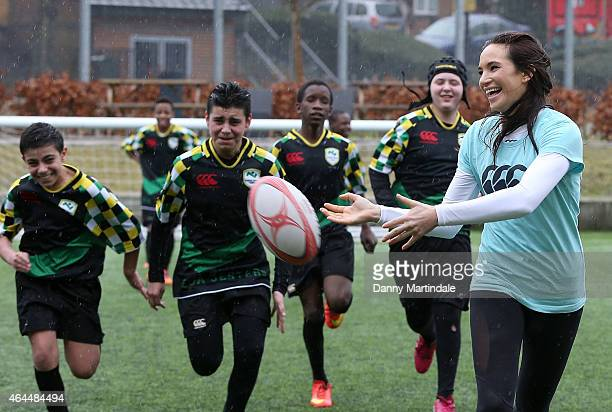 Sporting Soprano Laura Wright attends the Evelyn Grace Academy school as part of the All Schools Rugby campaign where she played rugby and performed...
