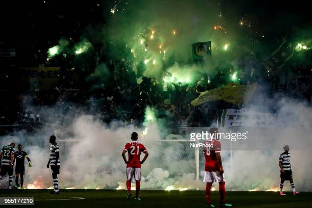 Sporting supporters light flares during the Portuguese League football match between Sporting CP and SL Benfica at Alvalade Stadium in Lisbon on May...