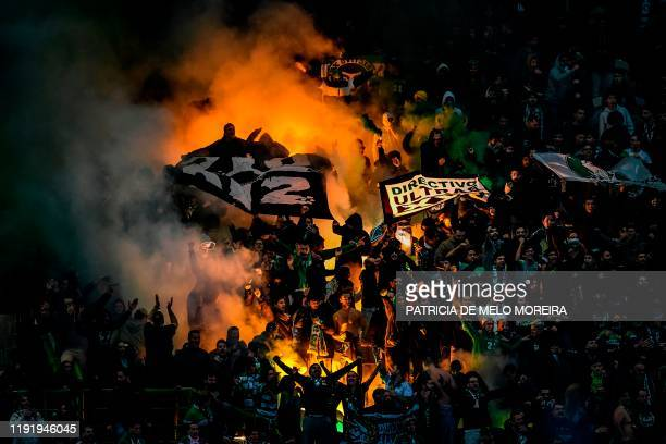 Sporting supporters light up flares during the Portuguese league football match between Sporting CP and FC Porto at the Jose Alvalade stadium in...