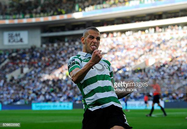 Sporting's Algerian forward Islam Slimani celebrates after scoring a goal during the Portuguese league football match FC Porto vs Sporting CP at the...