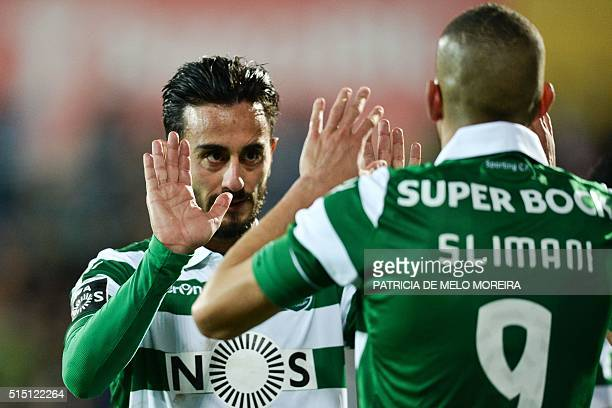 Sporting's Algerian forward Islam Slimani celebrates with his teammate Sporting's Italian midfielder Alberto Aquilani after scoring during the...