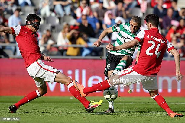 Sporting's Algerian forward Islam Slimani in action wit Braga's Portuguese defender Ricardo Ferreira during the Premier League 2015/16 match between...