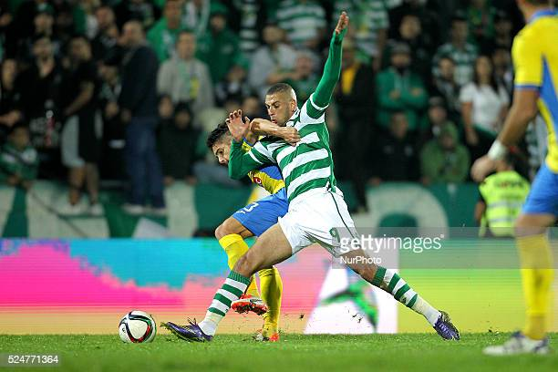 Sporting's Algerian forward Islam Slimani vies with Arouca's Portuguese defender Hugo Basto during the Premier League 2015/16 match between FC Arouca...