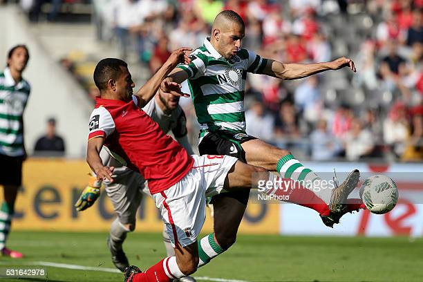 Sporting's Algerian forward Islam Slimani vies with Braga's Brazilian defender Marcelo Goiano during the Premier League 2015/16 match between SC...