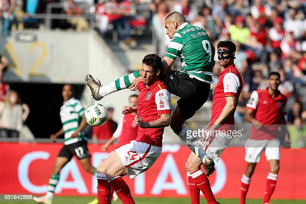 Sporting's Algerian forward Islam Slimani vies with Braga's Portuguese defender Ricardo Ferreira during the Premier League 2015/16 match between SC...