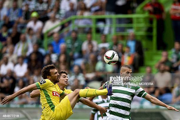 Sporting's Algerian forward Islam Slimani vies with Pacos de Ferreira's defender Marco Baixinho during the Portuguese league football match Sporting...