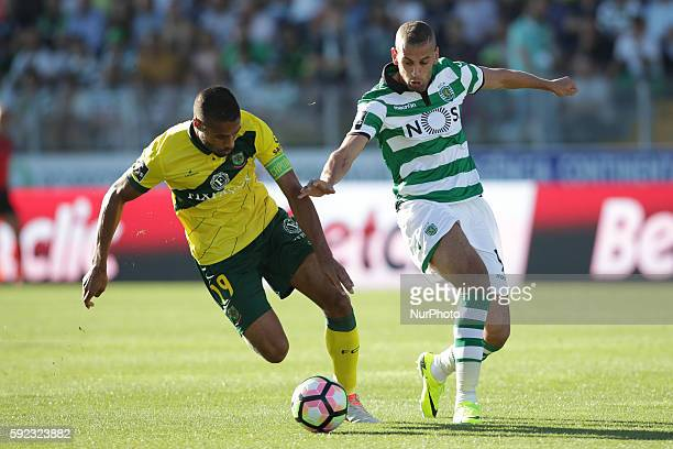 Sporting's Algerian forward Islam Slimani vies with Pacos Ferreira's Portuguese miedfielder Ricardo during the Premier League 2016/17 match between...