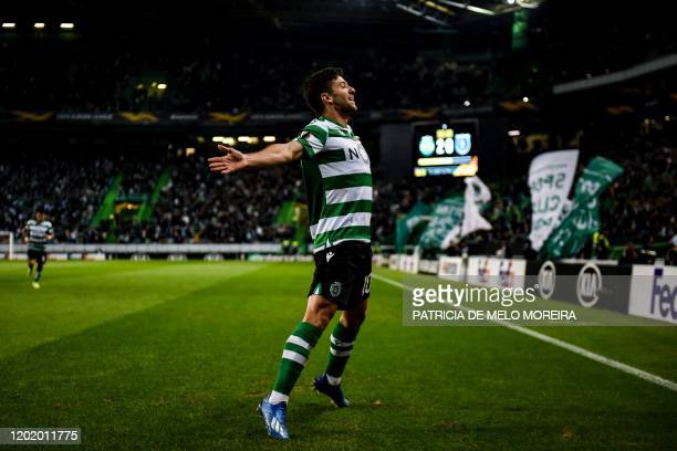 Sporting's Argentine forward Luciano Vietto celebrates after scoring during the Europa League round of 32 football match between Sporting CP and...