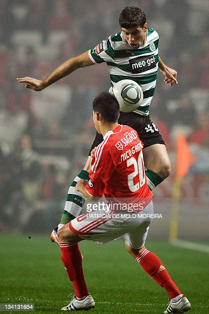 Sporting's Argentinian defender Insua vies with Benfica's Argentinian midfielder Nicolas Gaitan during their Portuguese league football match at the...