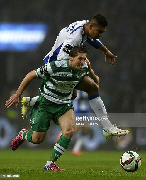 Sporting's Argentinian defender Jonathan Silva vies with Porto's Brazilian midfielder Casemiro during the Portuguese league football match FC Porto...