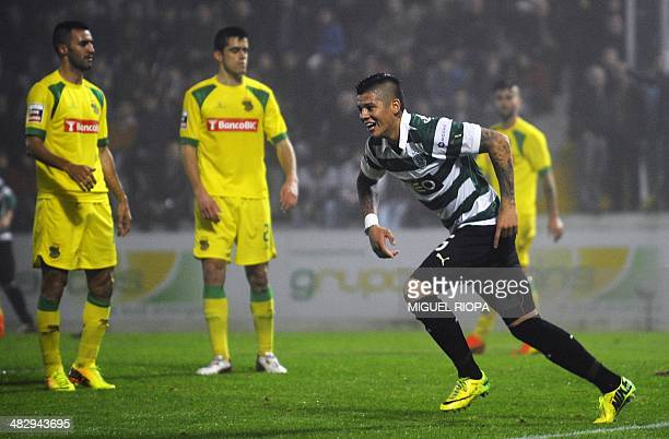 Sporting's Argentinian defender Marcos Rojo celebrates after scoring during the Portuguese league football match FC Pacos de Ferreira vs Sporting CP...