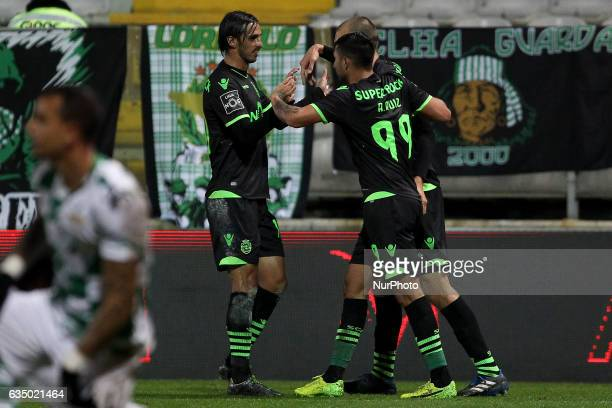 Sporting's Argentinian forward Alan Ruiz celebrates after scoring goal with teammates Sporting's Costa Rica forward Bryan Ruiz and Sporting's...