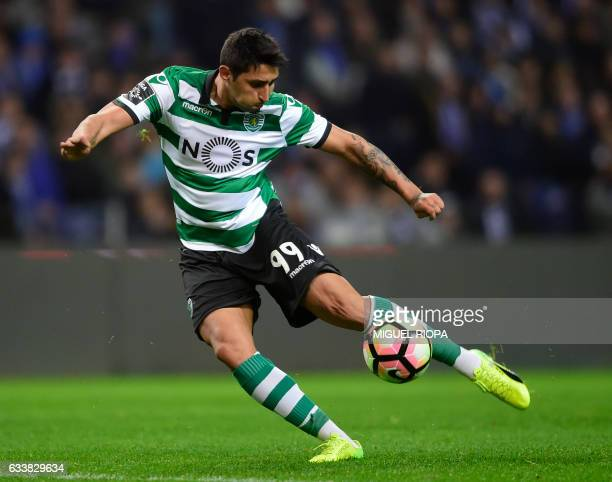 Sporting's Argentinian forward Alan Ruiz kicks the ball to score a goal during the Portuguese league football match FC Porto vs Sporting CP at the...