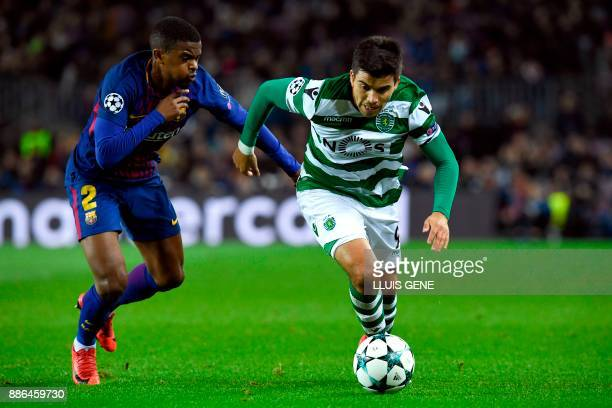 Sporting's Argentinian forward Marcos Acuna challenges Barcelona's Portuguese defender Nelson Semedo during the UEFA Champions League football match...
