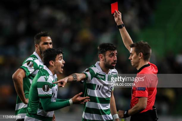 Sporting's Argentinian forward Marcos Acuna reacts as he receives a red card from French referee Clement Turpin during the UEFA Europa League round...