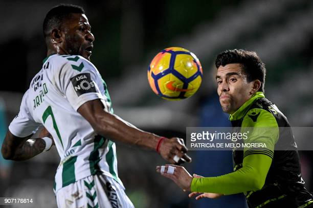 Sporting's Argentinian forward Marcos Acuna vies with Vitoria Setubal's Congolese forward Arnold Issoko during the Portuguese league football match...