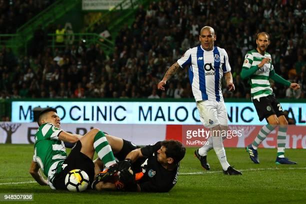 Sporting's Argentinian forward Rodrigo Battaglia vies with Porto's Spanish goalkeeper Iker Casillas during the Portuguese Cup football match between...