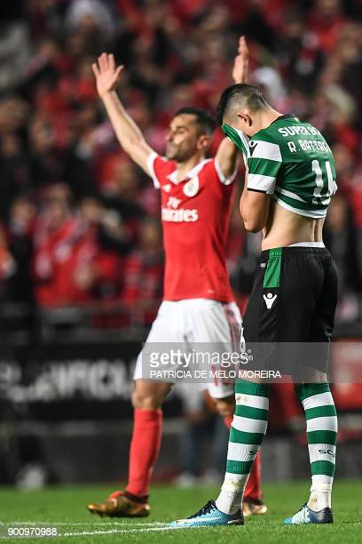 Sporting's Argentinian midfielder Rodrigo Battaglia gestures as Benfica's Brazilian forward Jonas Oliveira celebrates during the Portuguese league...