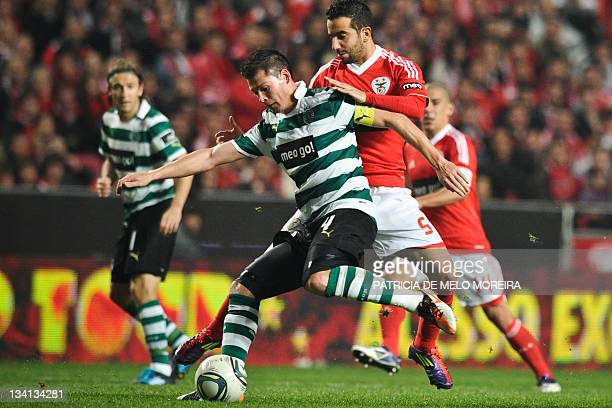 Sporting's brazilian defender, Anderson Polga fights for the ball with Benfica's midfielder Ruben Amorin R during their Portuguese league football...