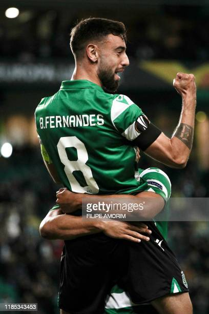 Sporting's Brazilian forward Luiz Phellype celebrates his goal with Sporting Lisbon's Portuguese midfielder Bruno Fernandes during the UEFA Europa...