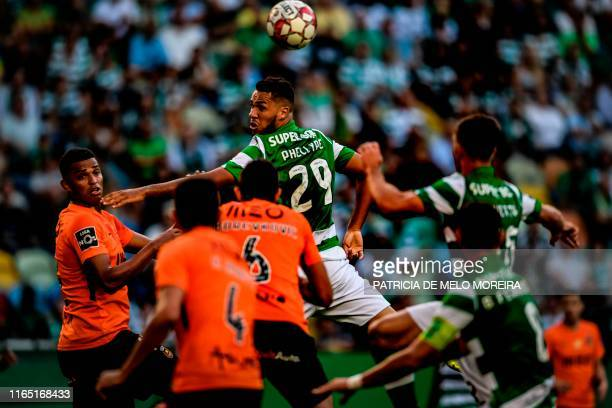 Sporting's Brazilian forward Luiz Phellype heads the ball during the Portuguese League football match between Sporting CP and Rio Ave at Alvalade...