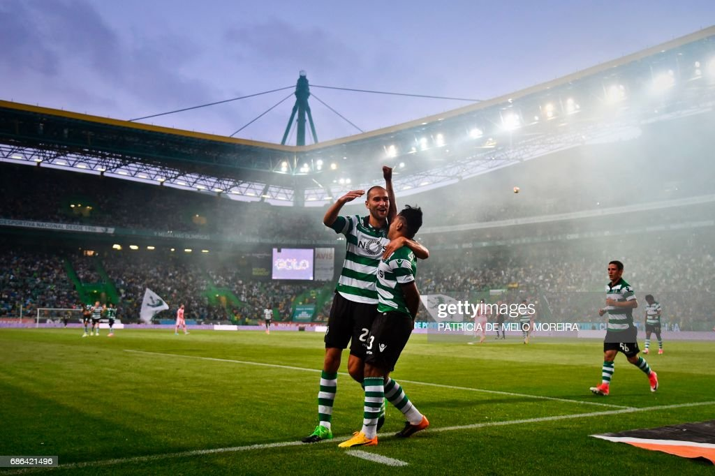 Sporting's Brazilian forward Matheus Pereira (R) celebrates with his teammate Sporting's Dutch forward Bas Dost (L) after scoring during the Portuguese league football match Sporting CP vs GD Chaves at the Jose Alvalade stadium in Lisbon on May 21, 2017. /